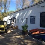 Fisherman's Catch & Grill exterior with van Whale Cottage Portfolio