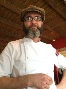 Foliage Chef Chris Erasmus at table Whale Cottage